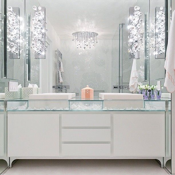 Website Photo Gallery Examples Stunning bathroom with glass top double vanity accented with white vessel sink and wall mounted faucets paired with glass bubbles sconces on ceiling height