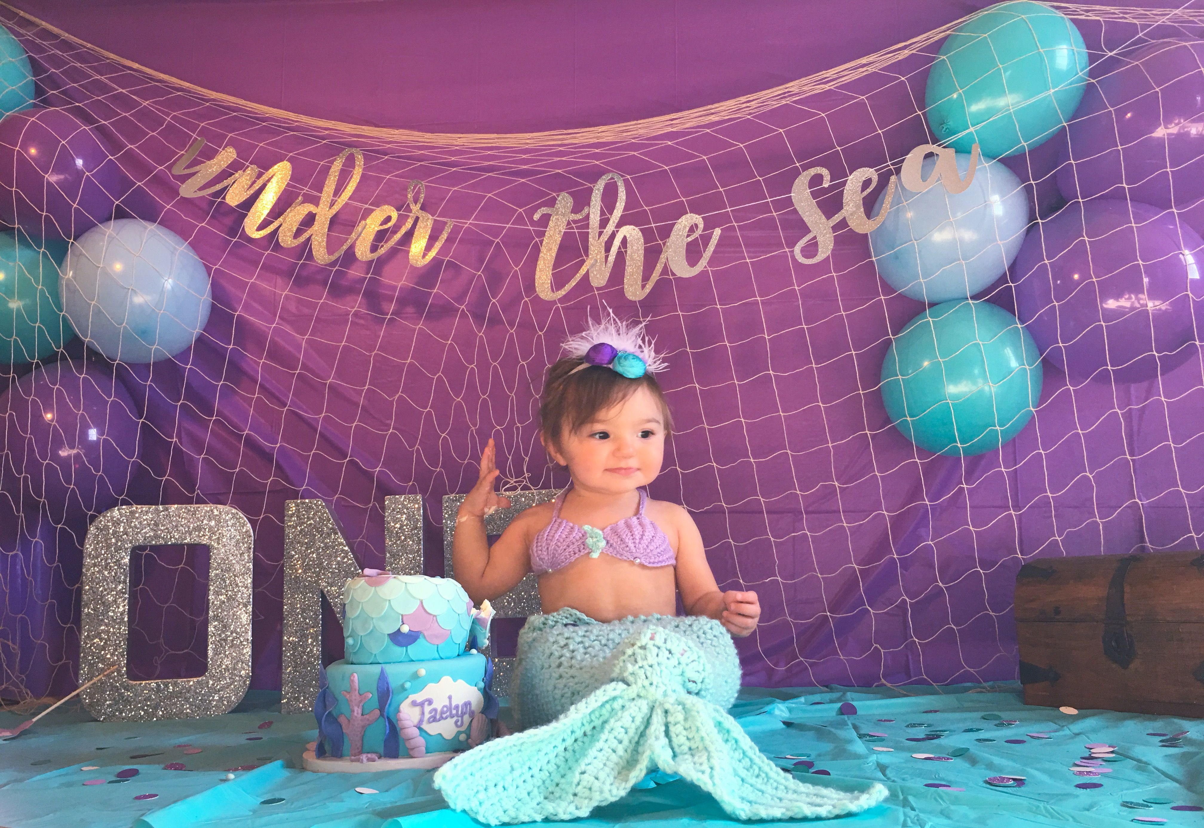 71aae5dc074 My daughter on her first birthday. Mermaid themed cake smash