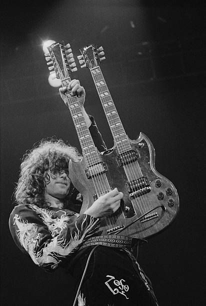 Jimmy Page playing a Gibson double neck guitar on