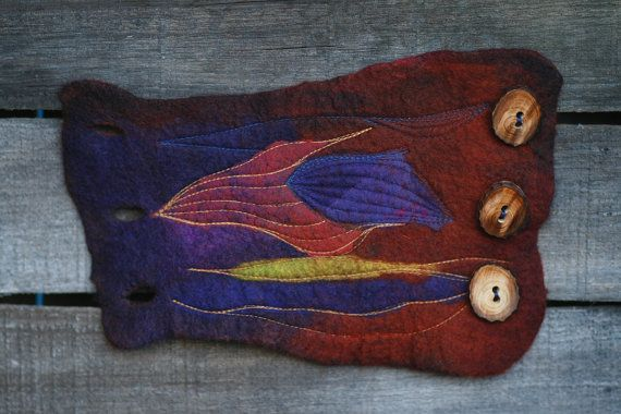 RESERVED for R.  This is an individual nuno felted cuff. Made from merino wool and embroidered with with blue and caramel threads, emphasizing
