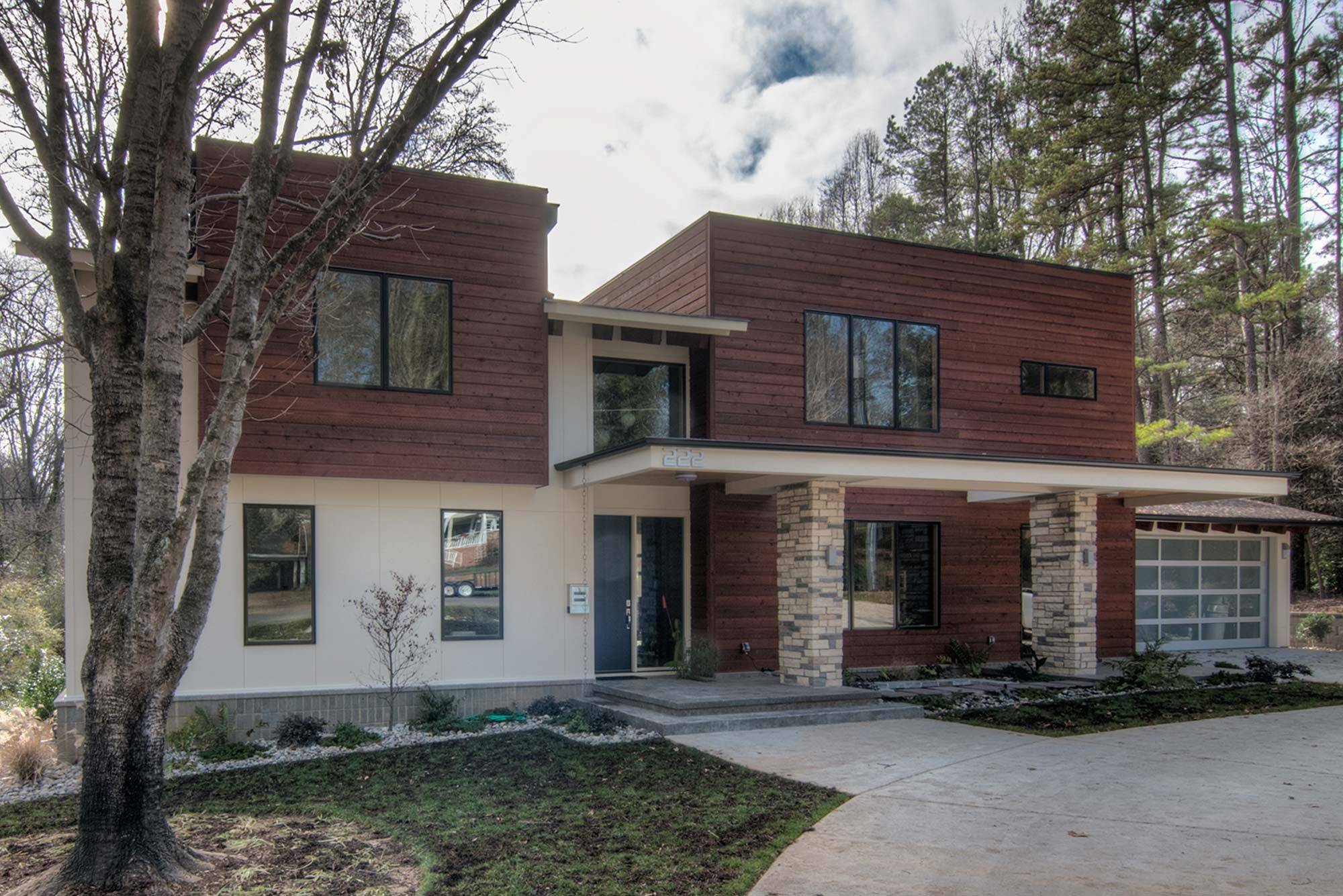 Modern White House And Brown Wood Siding
