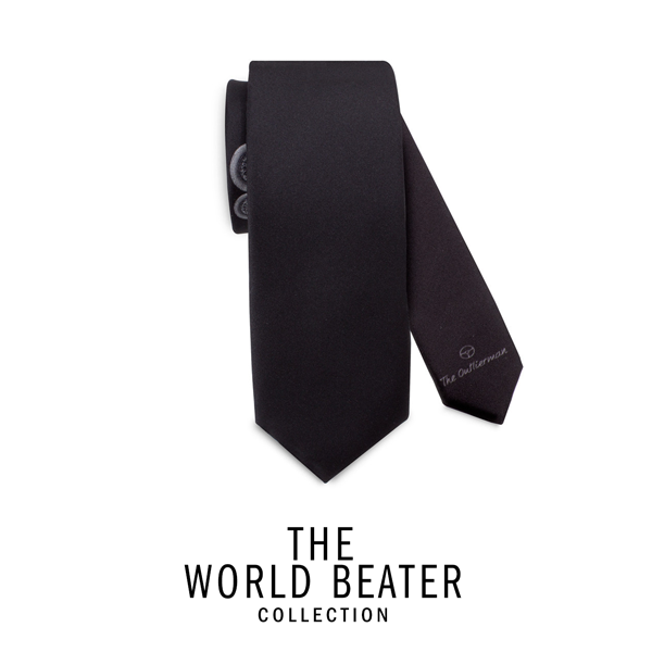 Jaguar E-Type: a few syllables that include a world, a style. The world-beater of its era marks this tie handmade in Italy with the perfect fit of its roundness. A creative packaging with a driving essence allows each product to be the most exclusive gift for every occasion. Color: black  Fabric: 100% twill silk, 18 momi  Width: 7 cm MADE IN ITALY ID: TWB304