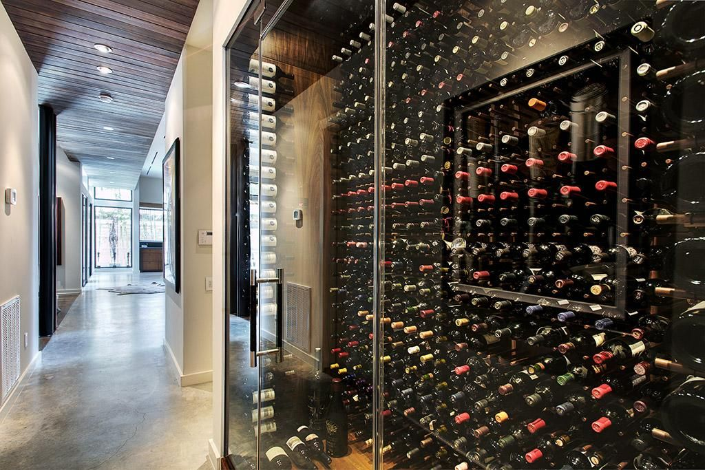 Refrigerated Wine Room In Entry Hall Makes For A Stunning Entry