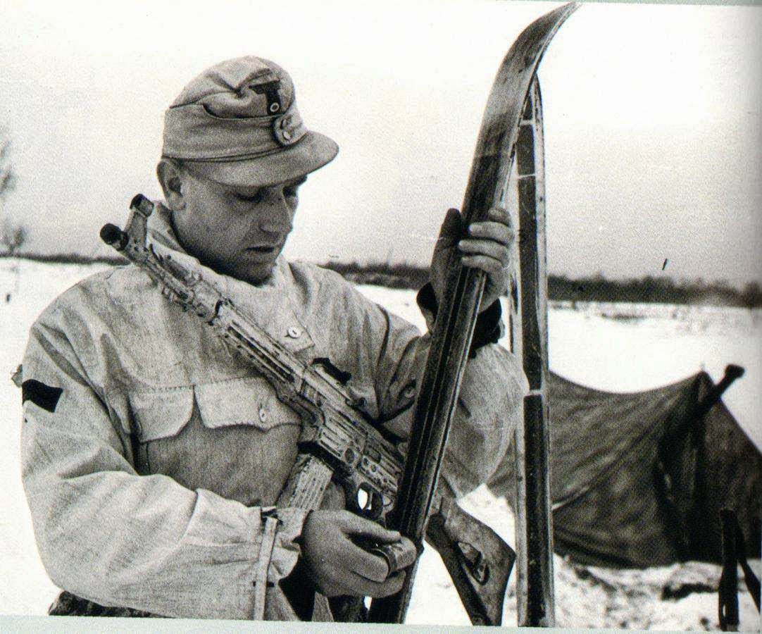February 1944, Ukraine, Pripiat, a soldier of the 1st Ski Hunter Division, armed with a StG 44 prepares his skis.