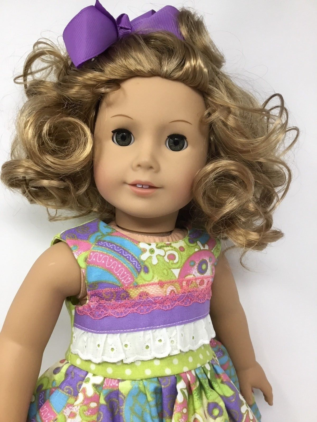 American girl doll curly blonde hair with hazel eyes with
