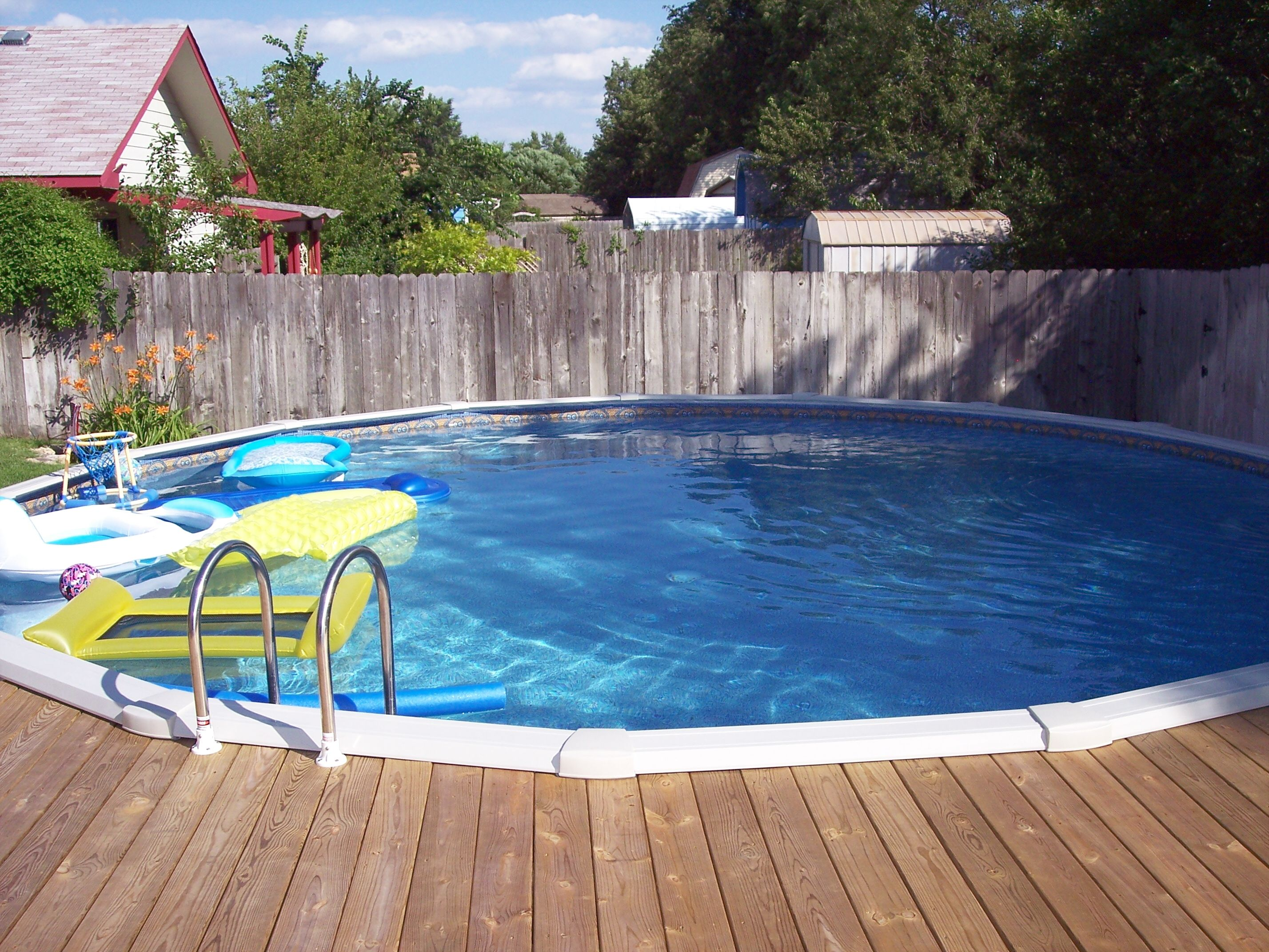 view from the deck of above ground pool lowered 24