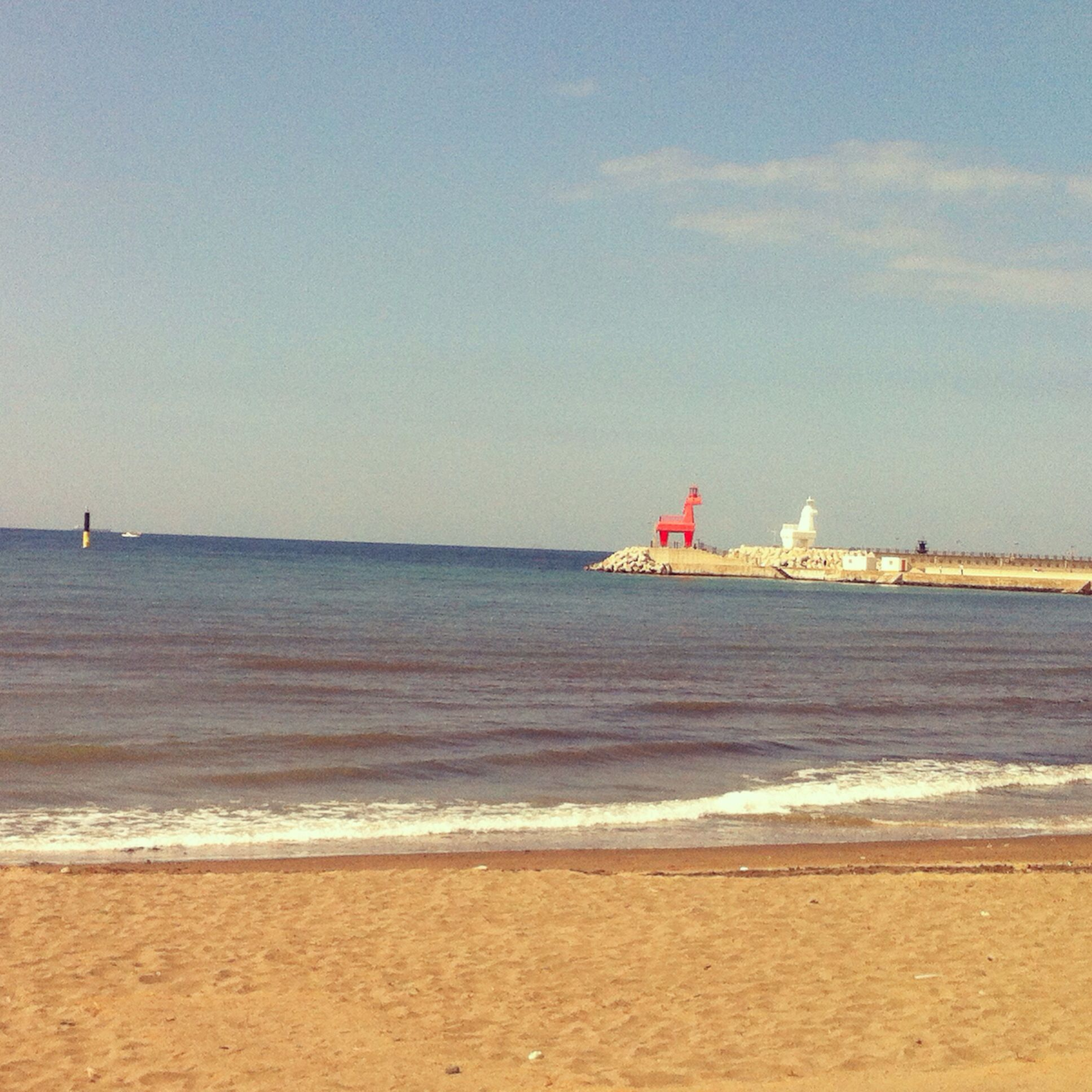 Jeju Island Beaches: Two Horse Lighthouses At Iho Tewoo Beach In Jeju Island