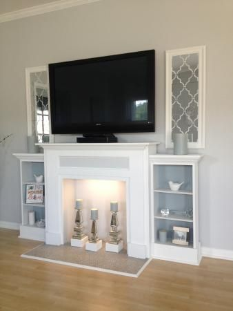 this faux mantle with candles and side shelves for a