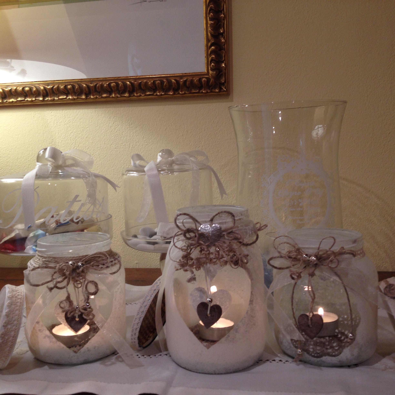 Vari vasetti di vetro recuperati e decorati con pittura ad - Vasetti vetro decorati ...