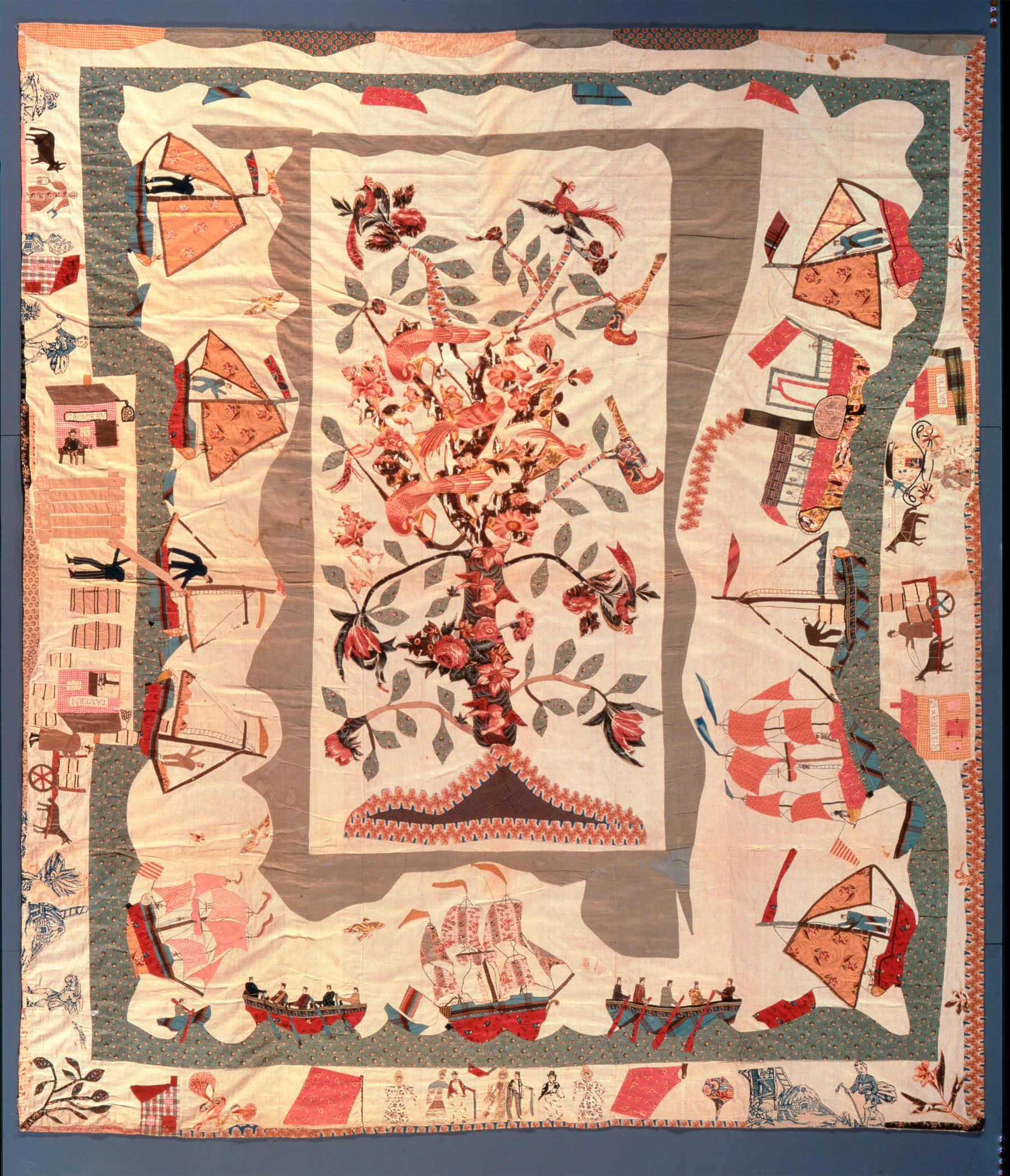 """One of the most unusual quilts ever made in America, known as """"Trade and Commerce"""". Its maker was clearly familiar with the busy river commerce so important in the development of New York State. This unique pictorial quilt, made about 1825 by Hannah Stockton Stiles, is a lively appliqué depiction of life along the shores and on the waters of a major river.   From: Inspired Traditions: Selections from the Jane Katcher Collection of Americana.  Fenimore Art Museum, Cooperstown, NY, 2011"""
