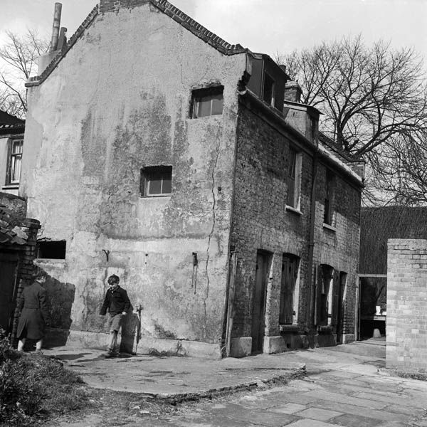 Two boys playing in a derelict street in 1951 (photo courtesy of Henry Grant)