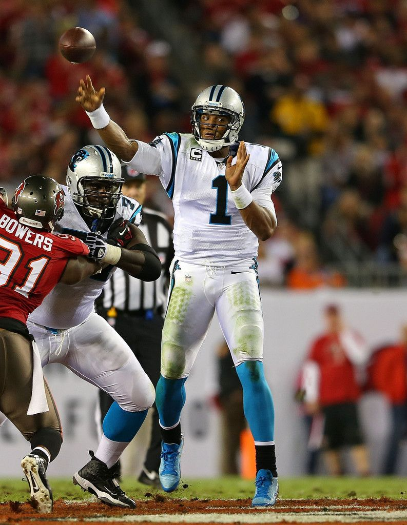 Cam newton 1 of the carolina panthers passes during a