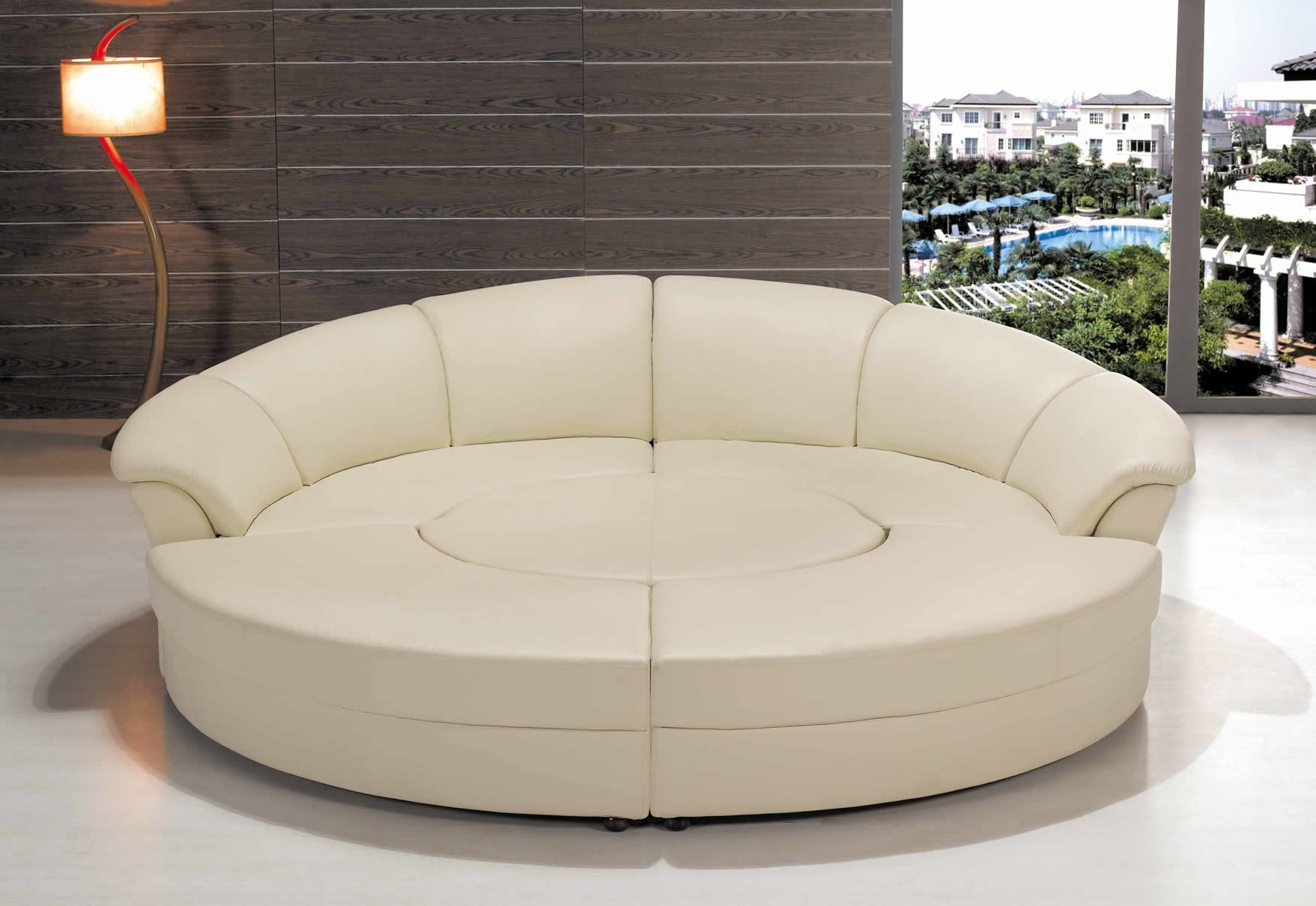 white leather round bed with curvy white headboard added