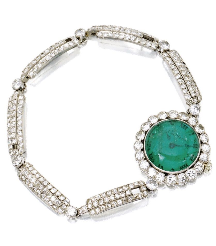 An Art Deco Platinum, Emerald and Diamond Watch, Cartier, France, Circa 1920. The circular dial set with a cabochon emerald crystal framed by old European-cut diamonds, the bracelet set with old European-, single- and rose-cut diamonds, manual movement, dial signed Cartier, French assay mark, movement signed European Clock & Watch Co. Inc., numbered. #Cartier #ArtDeco #watch