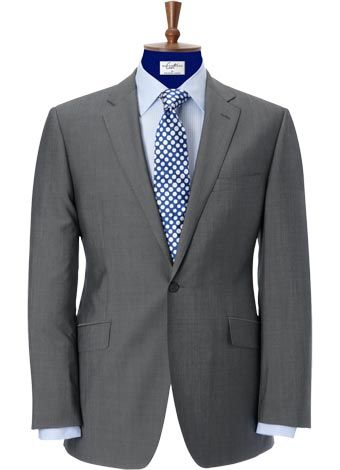 dark grey suit light blue dress shirt and blue polkadot