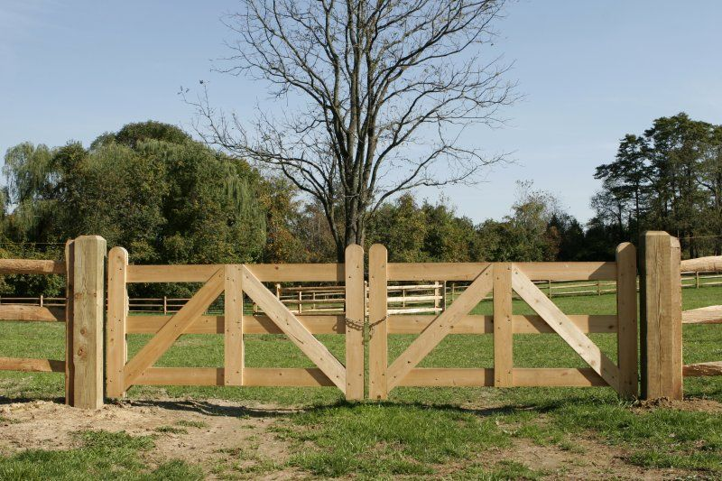 Double Fence Gate post and rail farm fence with a double cypress gate--maybe gates