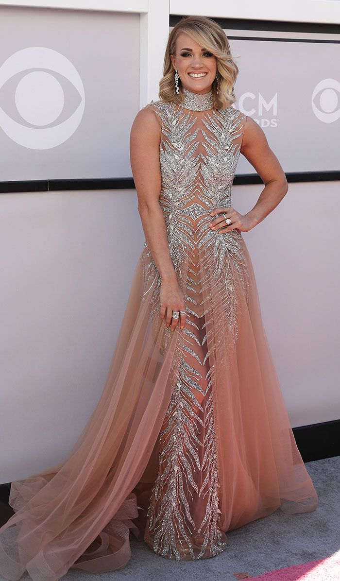 Carrie Underwood came looking like a big winner in a glittery gown made by fashion house LaBourjoisie