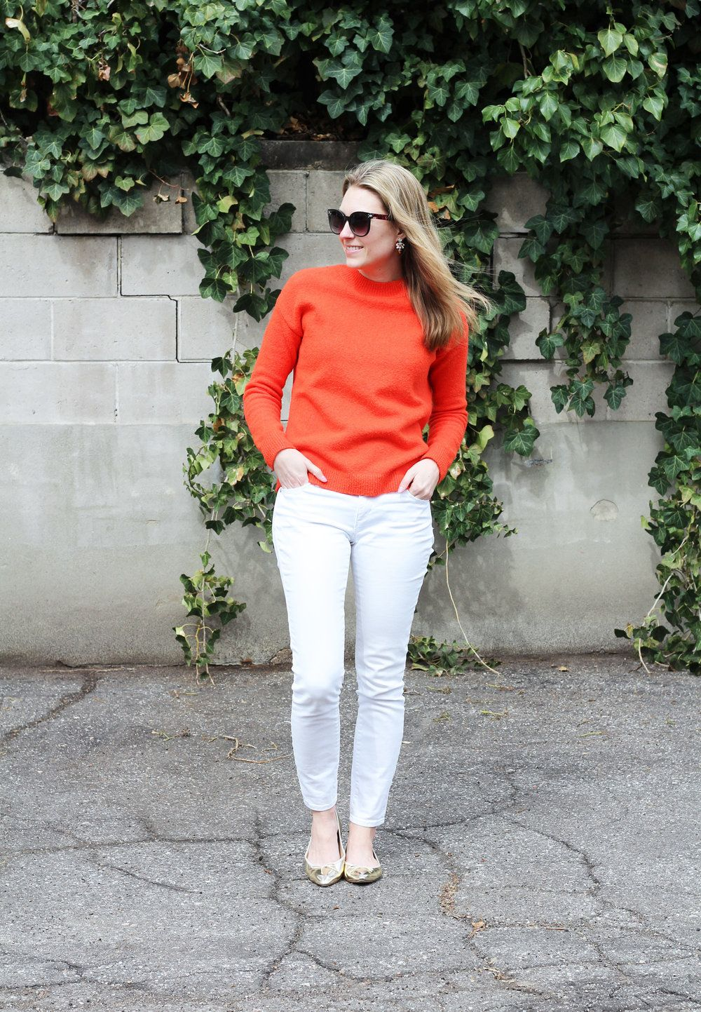 Simple but super cute look. Love the bright sweater with the white bottoms and bright flats.