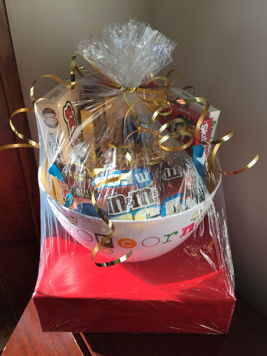 movie theme bridal shower gift basket movie trivia game wrapped in red paper red carpet popcorn bowl filled with corn to pop and movie theater