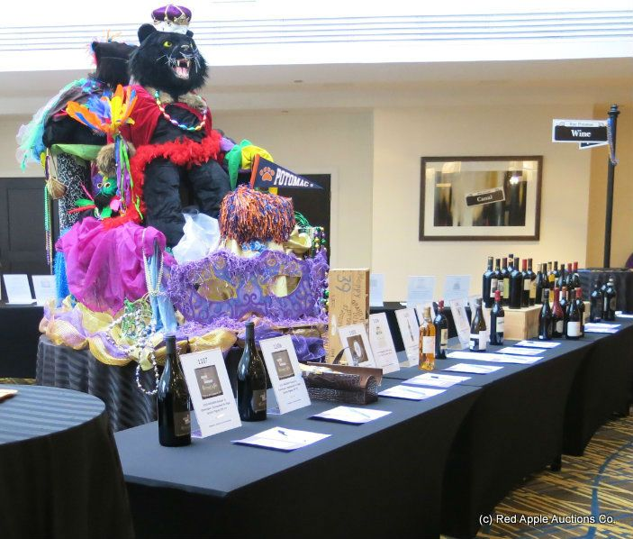 Large 'parade' decor in silent auction at the school fundraiser #MardiGrasAuction