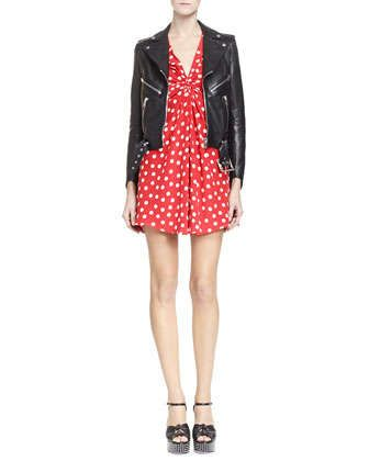 Leather Motorcycle Jacket with Belted Waist & Long Sleeve V Neck Polka Dot Dress by Saint Laurent at Neiman Marcus.