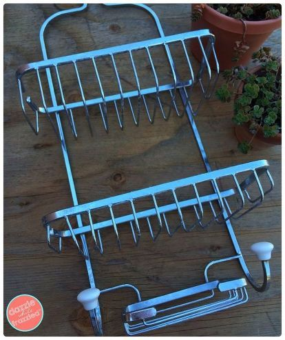 A Genius Use for an Old Shower Caddy (not for Your Bathroom) is part of Shower caddy, Diy hanging planter, Wall planter, Vertical planter, Spring outdoor decor, Hanging plant holder - When I came across a cheap (read free) shower caddy, I snatched it up  Not because I needed more storage in the bath but because I had the perfect place in the garden for it  Yes! This holder of shampoo bottles would make for a great vertical wall planter  These wall gardens are ideal for adding a decorative touch to an otherwise plain wall  And are perfect for urban gardeners with limited space  I started the project by giving the shower caddy a coat of primer + paint in the col…
