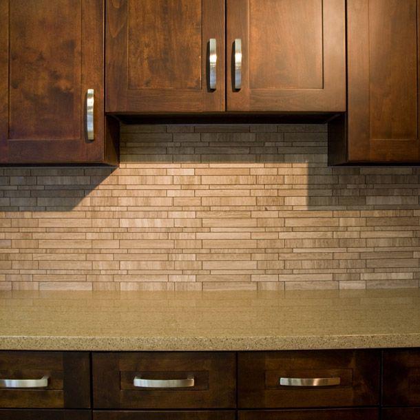 warm grey marble mosaic tile used as a kitchen backsplash