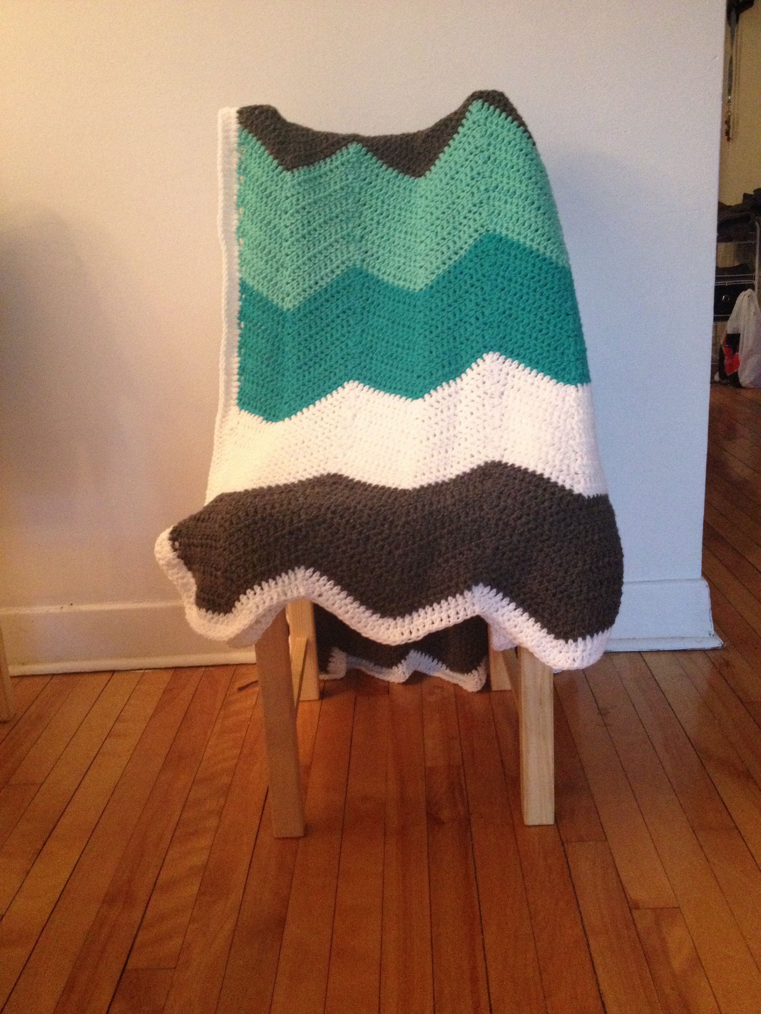 Crocheted myself a chevron patterned blanket! Blue, mint blue, grey, and white :)