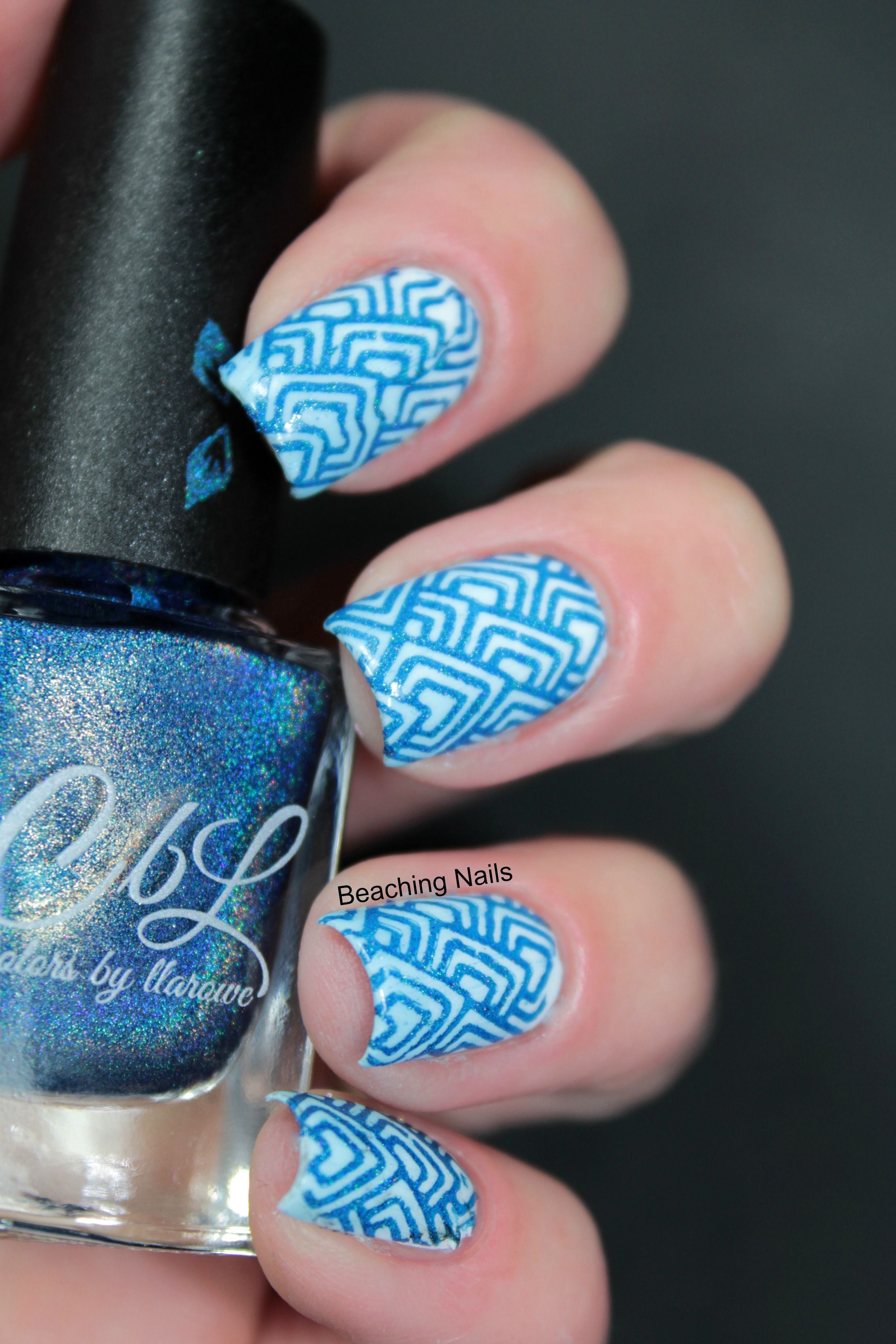 Colors by llarowe Stamping Polish - Royalty stamped over white by @beachingnails. Click on the pic to take you to the website's product listings.
