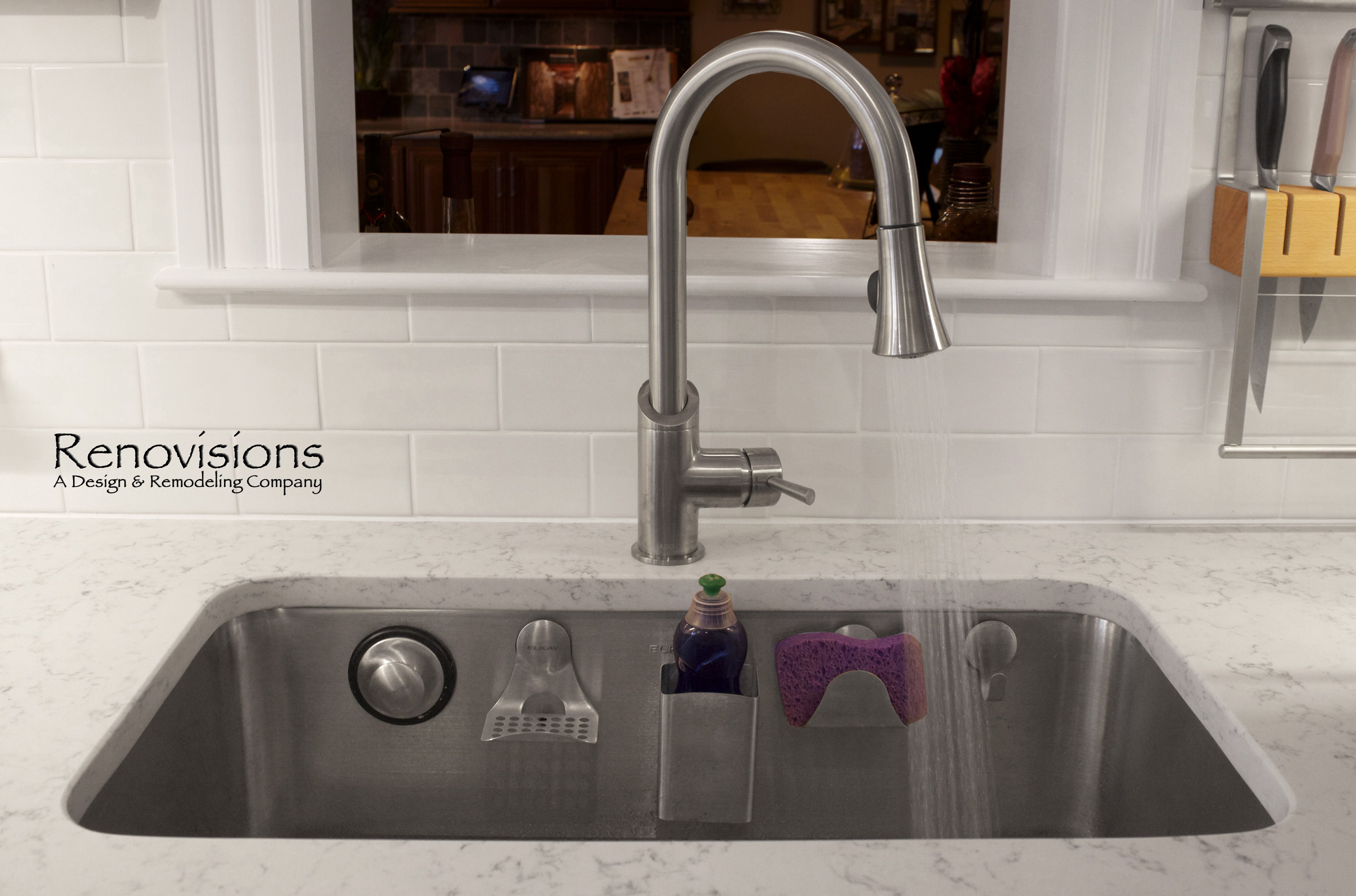 Elkay Stainless Steel Sink With Perfect Drain And Magnetic Sink Accessories  Called E Dock.