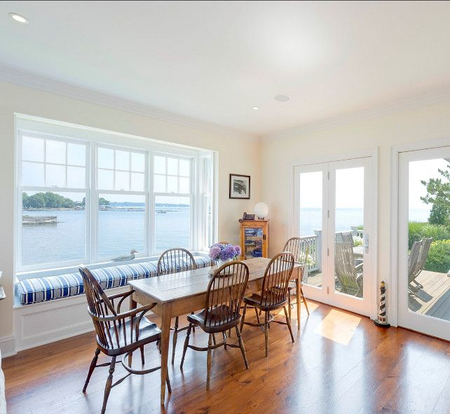 "Eating Nook. Eating nook with coastal decor. Take a look at the amazing ocean view this eating nook have! Similar Paint Color: Benjamin Moore ""Mannequin Cream"" OC-92  #EatingNook #EatingNookIdeas #EatingnNookDesign Vias Sotheby's Homes."