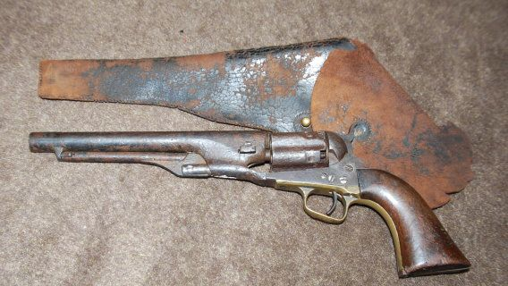 Rare Colt Model 1860 Percussion revolver with fluted cylinder and original holster, single action, .44 caliber--early Civil War weapons which were used by both the North and the South.