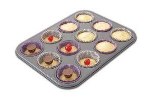 Chicago Metallic Non-Stick 12 Cup Surprise Cupcake or Muffin Pan by Chicago Metallic. $17.96. Create a fun surprise in every cupcake or muffin. Heavy duty construction; 12 cup capacity; pan measures 13.8 by 10.4 by 1.2-inch. Dishwasher safe; 25-year warranty. Place your favorite filling into each post, fill with batter, bake and enjoy. Easy release, non-stick coating for ease of baking and cleanup. Chicago Metallic is the preferred choice by bakers who understand quality, d...