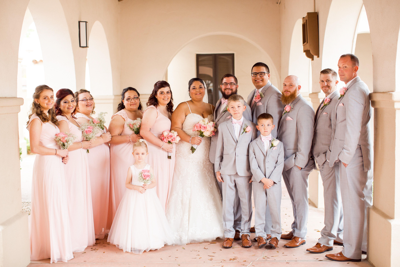 Bridesmaids Wearing Blush Pink Dresses And Groomsmen Wearing Light Grey Suits Light Pink Bridesmaid Dresses Light Grey Suits Wedding Pink Bridesmaid Dresses