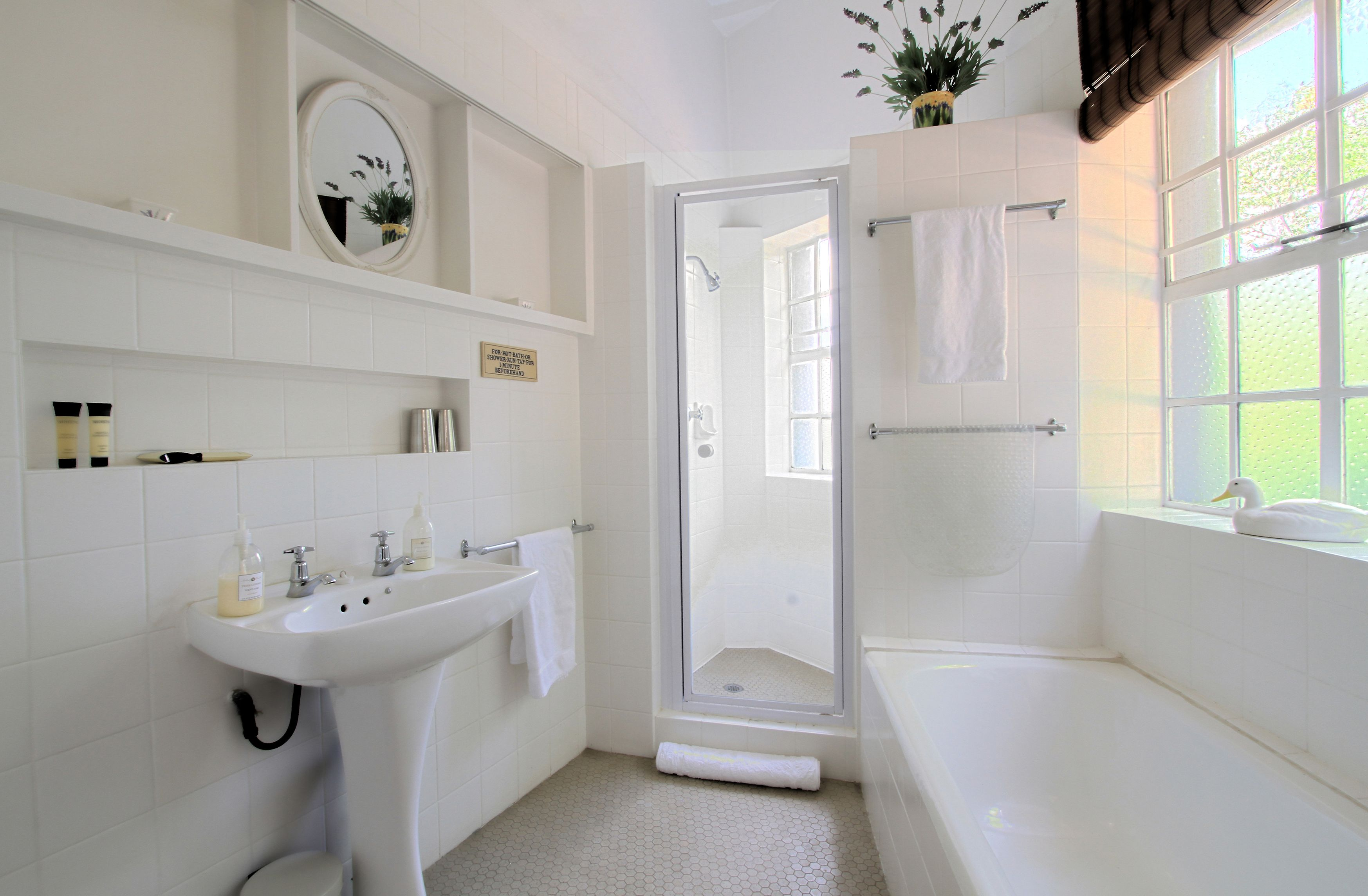 We love the white and off white color in this cozy little bathroom. www.PrestigePaints.com