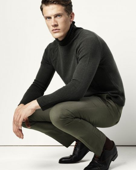 Jimmy wears turtleneck sweater Samsøe & Samsøe, trousers Cedarwood State, socks Item M6, and shoes Undandy.