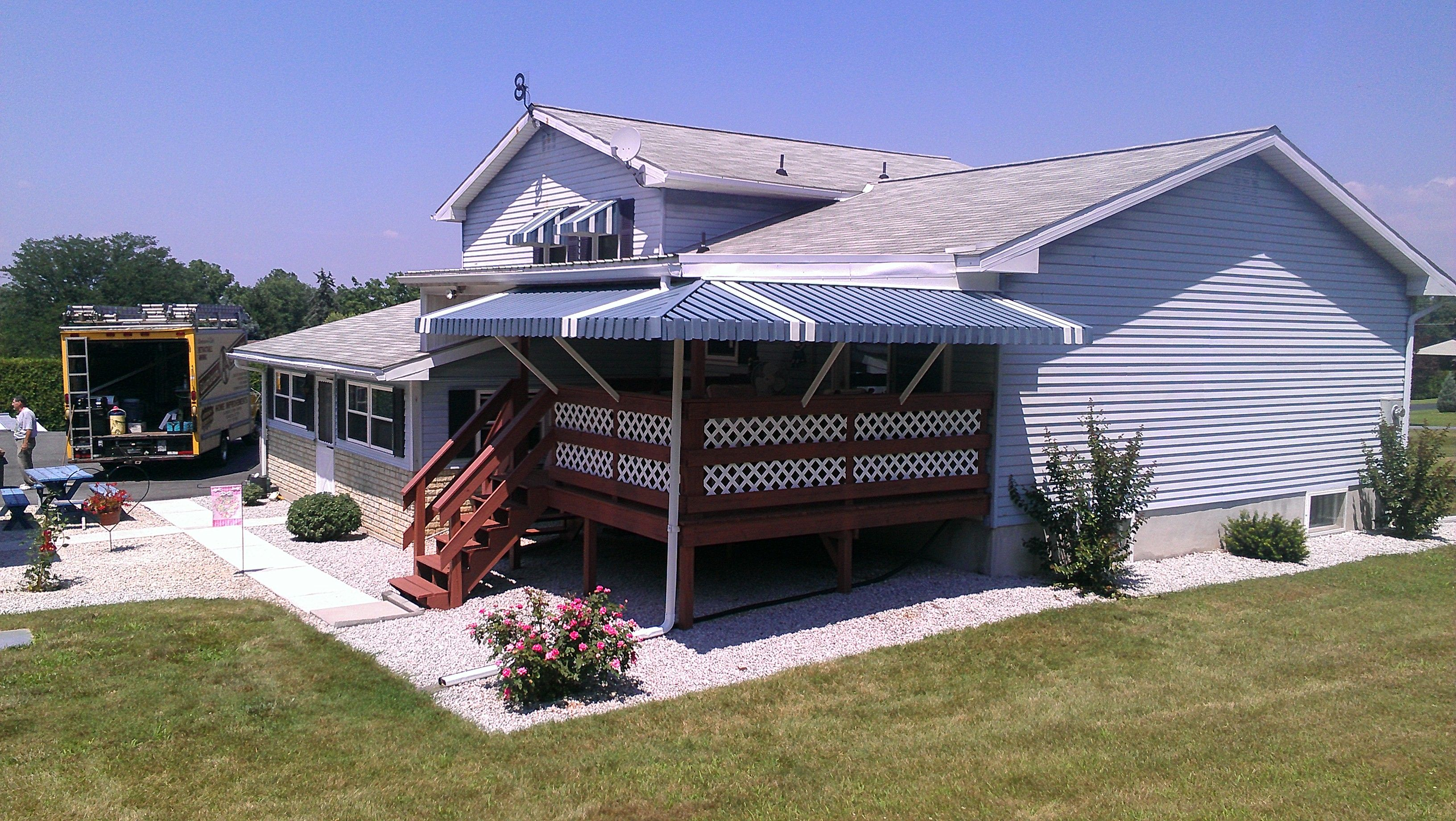under supplier marygrove cafeburgundyv wh lady innovative awnings services shade for porches awning cornelius nc