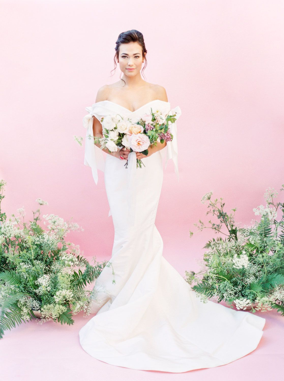 Bride in marchesa bridal gown spring off shoulder bow gown with