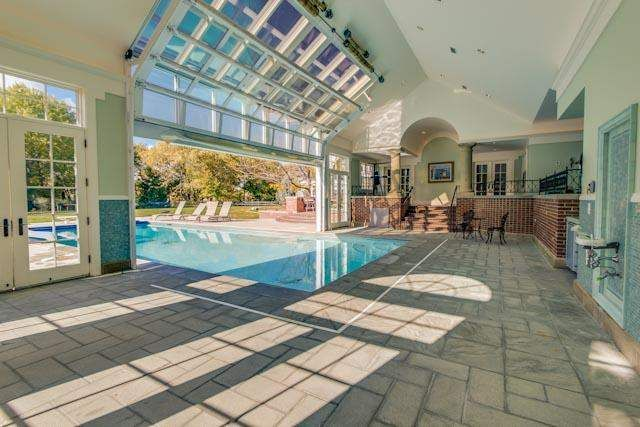 Indoor Pool With Reclaimed Fence Wood Lining The Inside