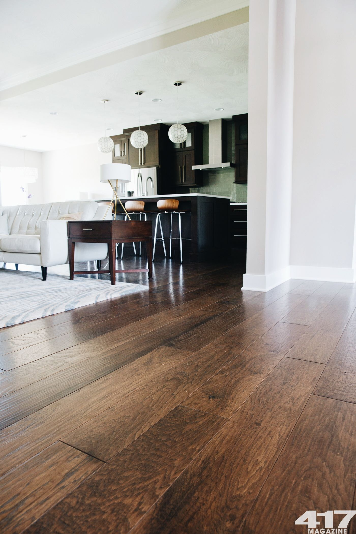 Love The Contrast Of The Dark Wood Flooring And White Walls Canoe Bay Amber Waves Hand Scraped 7 5 Wide P Wood Floors Wide Plank Hickory Wood Floors Flooring
