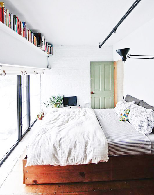 lovely reasons to be lazy. / sfgirlbybay  modern loft bedroom with long bookshelf. #bookshelf #bookshelves #shelving #bookstorage #storage   #Lazy #Lovely #Reasons #sfgirlbybay