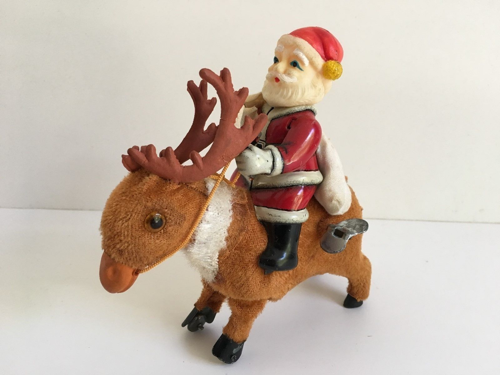 Antique s santa claus riding on movable head deer christmas