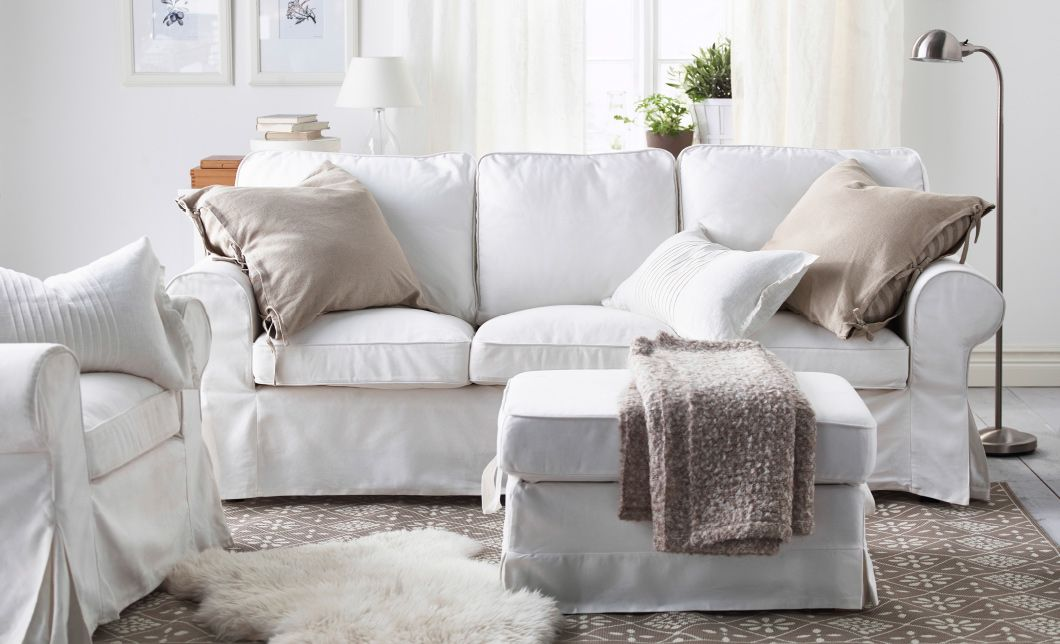 a living room with a white sofa and arm chair with beige and light brown cushions - Beige Weis Ikea