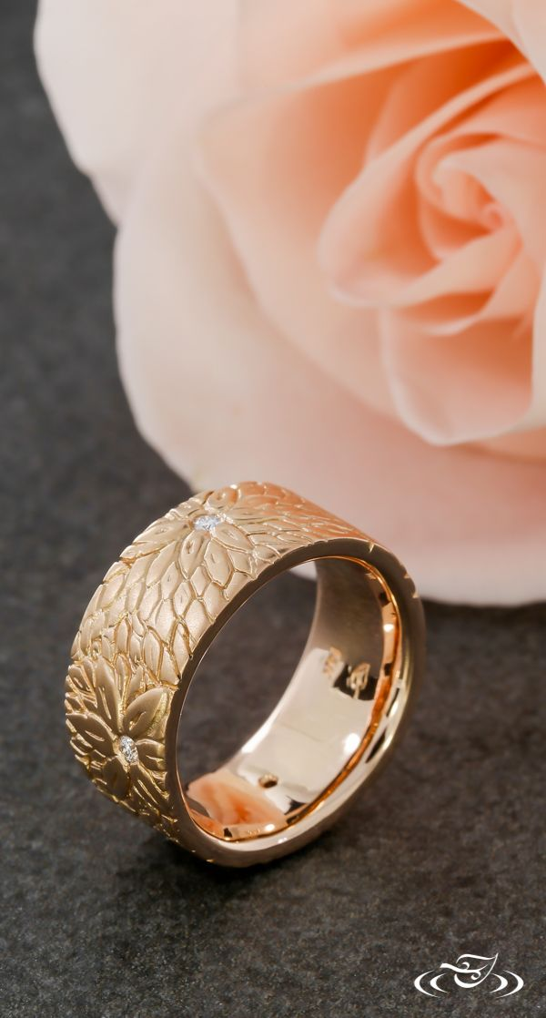 Matte rose gold flowers bloom in this rustic wedding band. Green Lake Jewelry