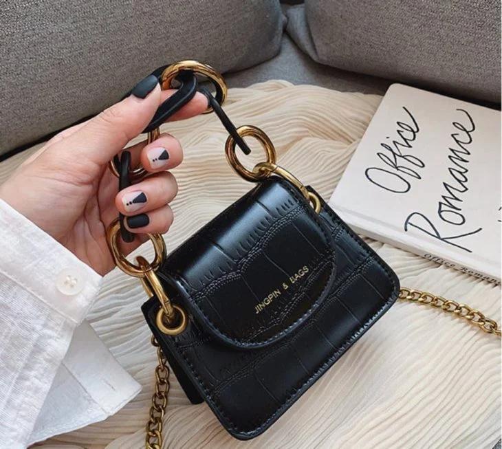 15 Minibolsos de manos para darle un toque chic a tu estilo  – Bolsa