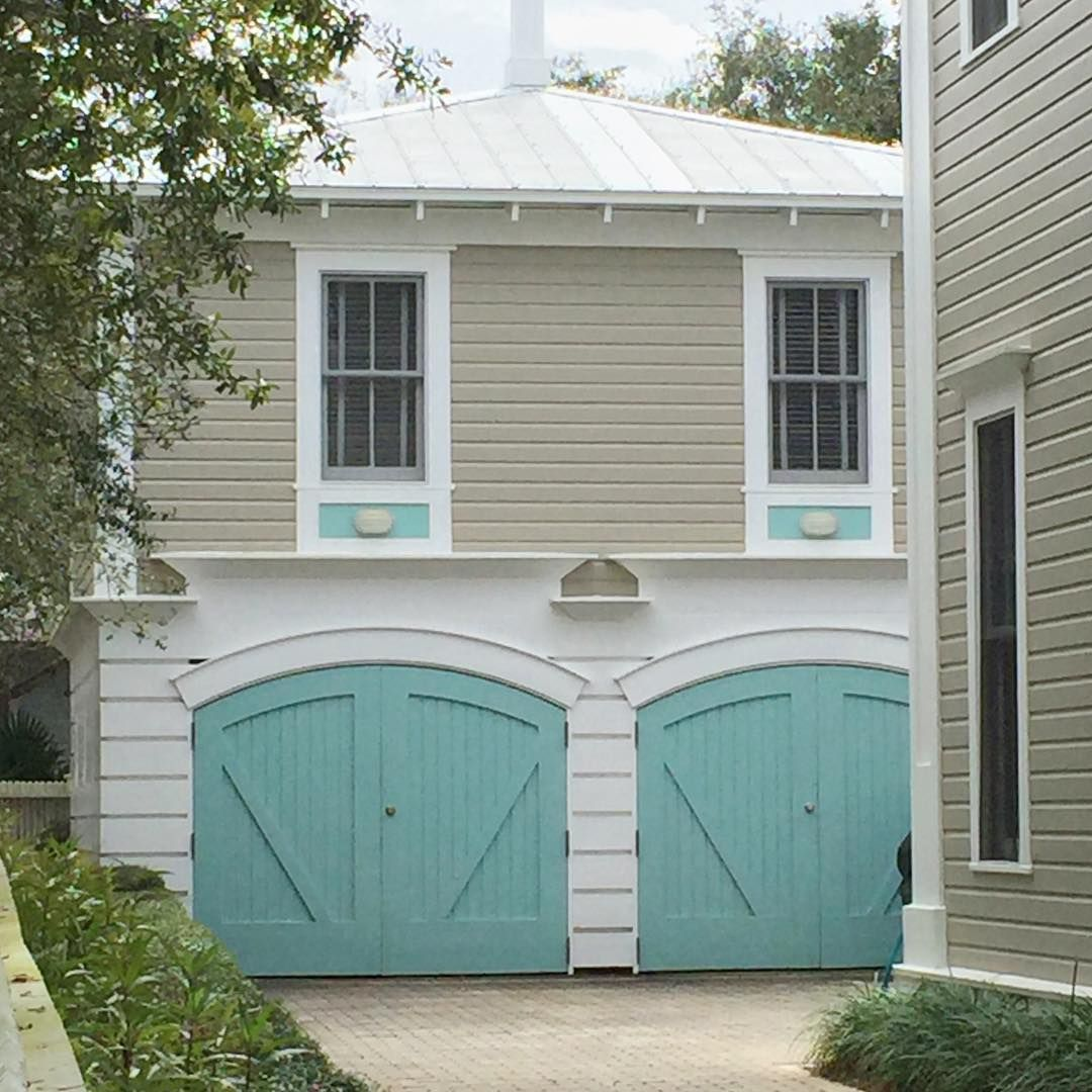 Turquoise garage doors garage inspiration house paint - Coastal home exterior color schemes ...