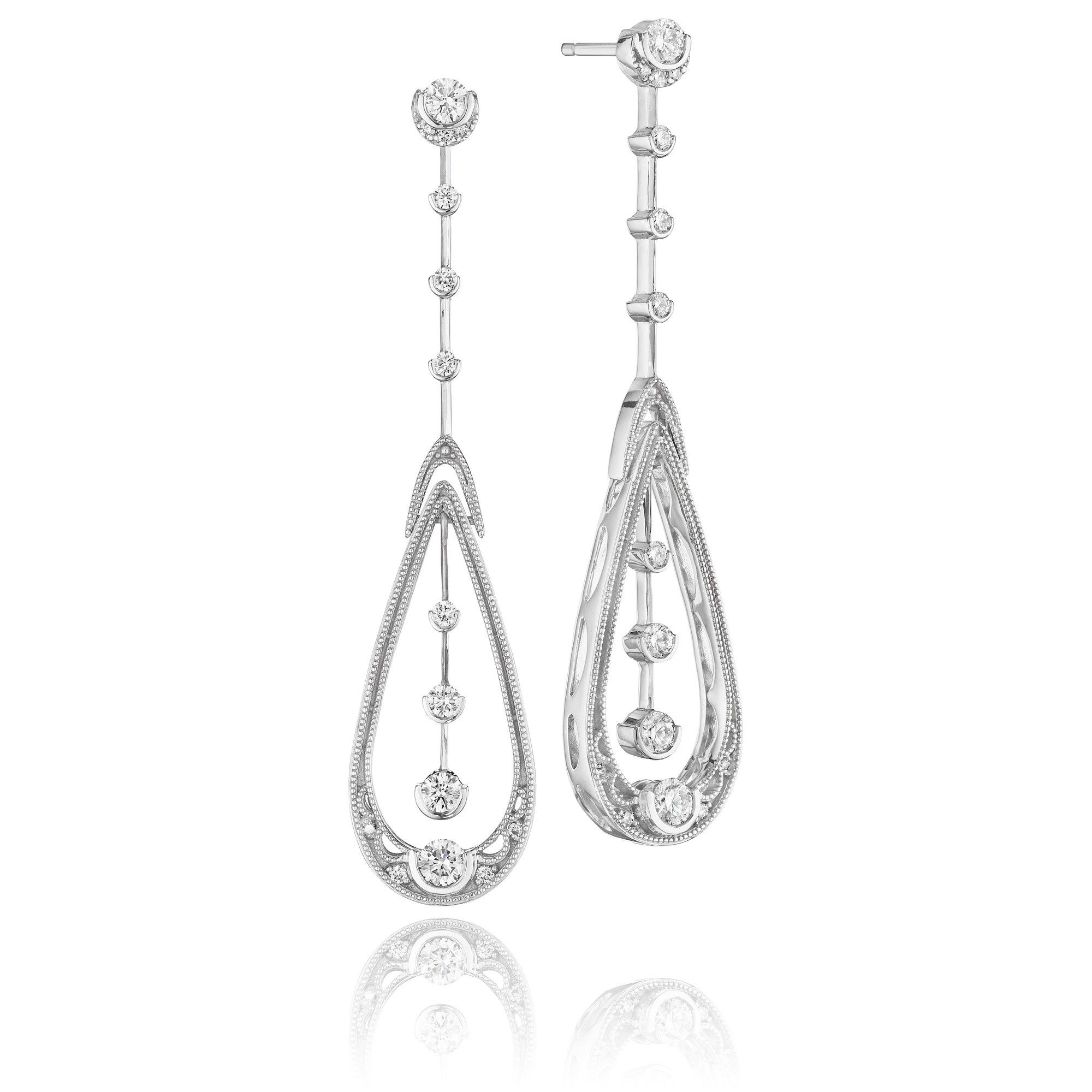 Diamonds appear to defy gravity inside an elegantly elongated pear shape on these ultra-sophisticated pair earrings for the Diamonds on the Moon collection by Tacori.