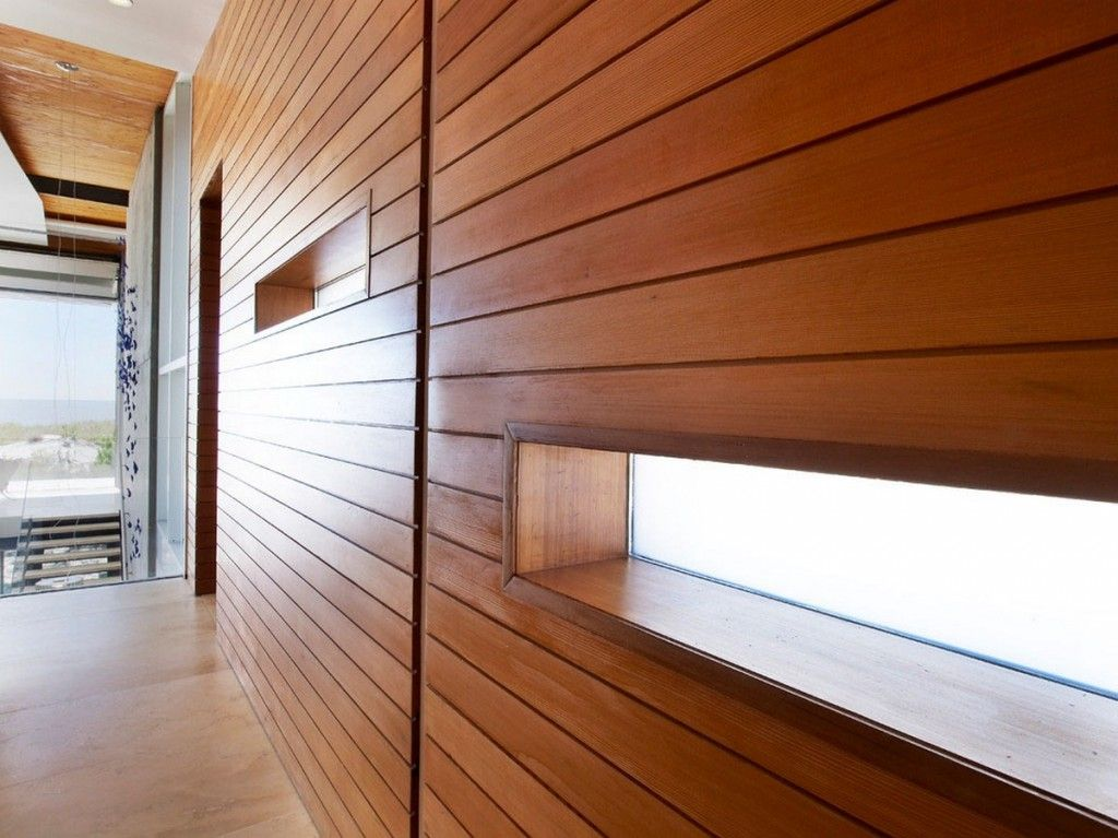 The Sea Project Beach House Interior With Foyer In Horizontal Wood Clad Siding For A Natural Aesth Beach House Interior Design Wood Slat Wall Wood Panel Siding