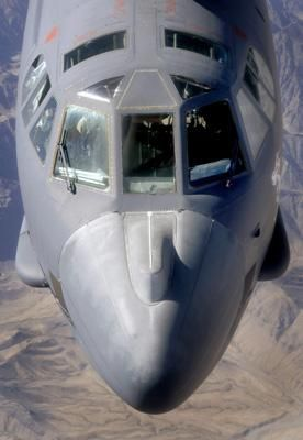 A B-52 Stratofortress bomber refuels during a close-air-support mission.