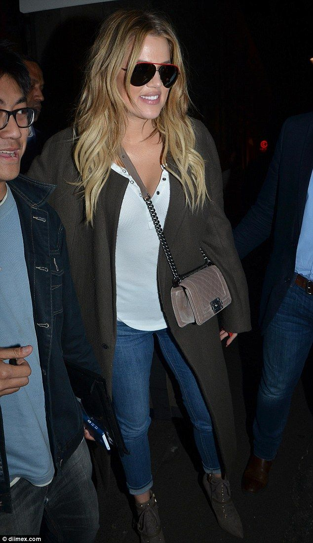 In the shade: Despite the late hour Khloe opted to accessorise with a pair of heavily tint...